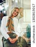 blonde girl wearing white... | Shutterstock . vector #1302815017