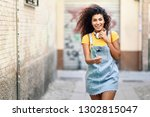 young african woman with... | Shutterstock . vector #1302815047