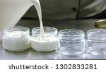 milk pouring into glass... | Shutterstock . vector #1302833281