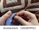 hands of woman embroidering... | Shutterstock . vector #1302859921