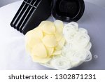 onion and potatoes at black... | Shutterstock . vector #1302871231