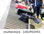 baggage luggage on conveyor... | Shutterstock . vector #1302902551