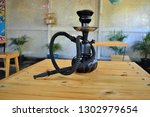 A Hookah Is A Water Pipe That...