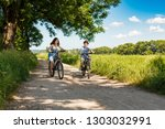urban biking   kids riding... | Shutterstock . vector #1303032991