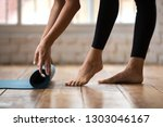 beautiful sporty girl rolling... | Shutterstock . vector #1303046167