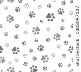 Stock vector dog paw seamless pattern vector footprint kitten puppy tile background repeat wallpaper cartoon 1303097137