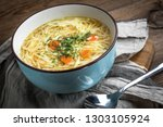 broth   chicken soup with... | Shutterstock . vector #1303105924