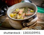 the sour soup made of rye flour.... | Shutterstock . vector #1303105951