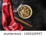 soup with pieces of pork and... | Shutterstock . vector #1303105957