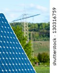 Solar Panel With Green Landscape Against The Blue Sky - stock photo