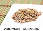 Small photo of Seed mixture on plate on tablemate, close-up