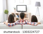 young friends watching tv at...   Shutterstock . vector #1303224727