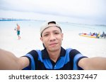 young man take photo selfie on...   Shutterstock . vector #1303237447