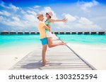 happy young couple having fun... | Shutterstock . vector #1303252594