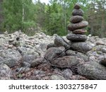 pile of round pebbles on the... | Shutterstock . vector #1303275847