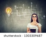woman with a book and pen... | Shutterstock . vector #1303309687