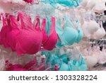 vareity of bra hanging in... | Shutterstock . vector #1303328224
