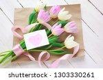 women's day. a bouquet of... | Shutterstock . vector #1303330261