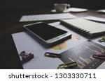 office desk table with notebook ... | Shutterstock . vector #1303330711