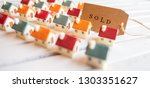 brown sold stamped text label... | Shutterstock . vector #1303351627