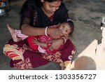 indian bengali tribal mother is ... | Shutterstock . vector #1303356727