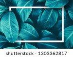 tropical leaf frame  dark blue...   Shutterstock . vector #1303362817