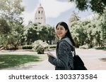 Stock photo female college student join short term summer tour program to learn language well in university 1303373584