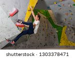 rock climber man hanging on a... | Shutterstock . vector #1303378471