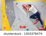 rock climber man hanging on a... | Shutterstock . vector #1303378474