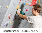 two white man's hands are held... | Shutterstock . vector #1303378477