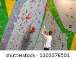 climber explores and develops a ... | Shutterstock . vector #1303378501