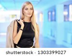 young blonde woman in black...   Shutterstock . vector #1303399027
