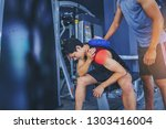 fit man with shoulder suffering ... | Shutterstock . vector #1303416004