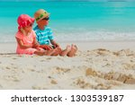 little boy and girl having fun... | Shutterstock . vector #1303539187