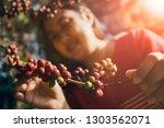 asian woman smiling face... | Shutterstock . vector #1303562071
