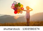 young happy woman with balloons ... | Shutterstock . vector #1303580374