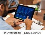 mature latin businessman... | Shutterstock . vector #1303625407