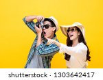 amazed excited young asian... | Shutterstock . vector #1303642417