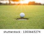golf ball putting on green...   Shutterstock . vector #1303665274