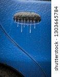 close up shot of a car's frozen ... | Shutterstock . vector #1303665784