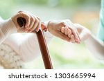 closeup of elderly lady holding ... | Shutterstock . vector #1303665994