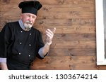 chef old in uniform with fresh... | Shutterstock . vector #1303674214