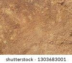 red dirt road texture soil... | Shutterstock . vector #1303683001