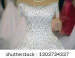 beautiful woman wedding dress.... | Shutterstock . vector #1303734337