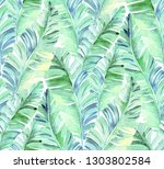 palm leaves pattern. bright and ... | Shutterstock . vector #1303802584