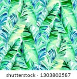 palm leaves pattern.  vibrant... | Shutterstock . vector #1303802587