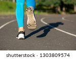 woman athlete legs during... | Shutterstock . vector #1303809574