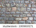 cobbled stone sidewalk after... | Shutterstock . vector #1303810171