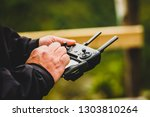 hand holding drone quadcopter... | Shutterstock . vector #1303810264