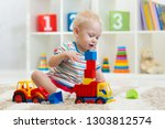 nursery kid boy toddler playing ... | Shutterstock . vector #1303812574